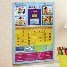 Magnetic Learning Calendar - The perfect first calendar helps kids learn calendar terms and how a calendar works by moving colorful illustrated magnets into place.