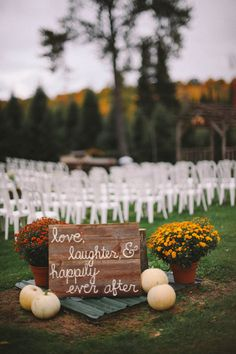 Outdoor Fall Wedding Ceremony with love the sign and pumpkins