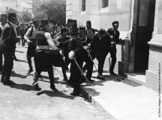 Police in Sarajevo arrest a man after a failed assassination attempt on the life of Archduke Franz Ferdinand, heir to the throne of the Austro-Hungarian Empire. The arrested man previously thought to be Gavrilo Princip, who succeeded in killing the Archduke the same day, is now thought to be one of his six co-conspirators Nedeljko Cabrinovic. The assassination was one of the causes of WW I. (Photo by Milos Oberajger/Topical Press Agency/Getty Images)