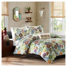 With its rich colors and intricate design, the Tula Duvet Cover Set brings sophisticated style to your bedroom. The eye-catching pattern combines paisley with stylized floral medallions in shades of deep eggplant, rusty red, apple green, pale gray and soft blues. Made from machine-washable polyester, this bedding set includes an ivory decorative pillow with elegant embroidered detailing for a final touch of class.