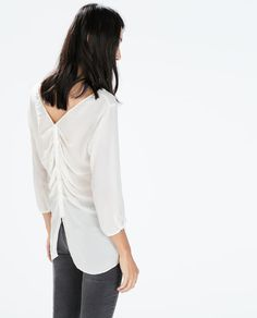 TOP WITH BACK DETAIL 49.90 USD