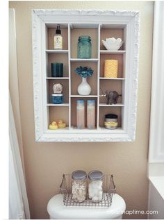 DIY bathroom storage from old frame