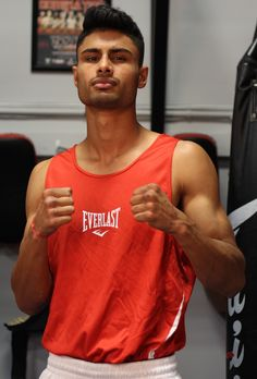 Located in South Calgary, the Southpaw Boxing Gym and The Goldenstars Boxing Team cater to Boxers in Calgary looking to win tournaments or get in shape. Boxing Gym, Get In Shape, Boxer, Tank Man, Champion, Mens Tops, Getting Fit, Boxer Dogs, Boxer Pants