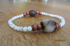 Bracelet with topaz gemstone bead and a matte brown czech glass bead  $20 www.etsy.com/shop/casanoni