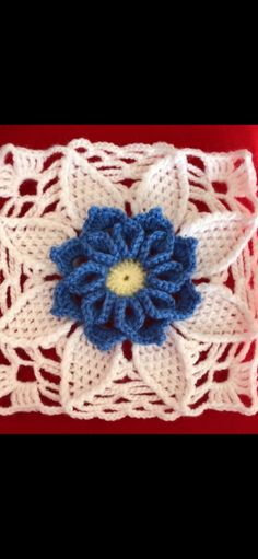 Crocheted square with 3D flower
