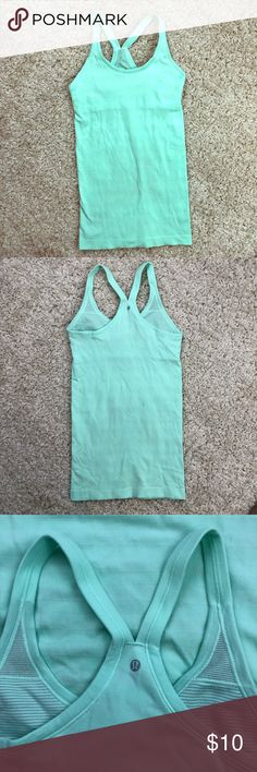 Lululemon Teal Blue Workout Tank Top Lululemon athletica brand. Size is unknown, but it appears to be a size 2!  Overall good condition; has one very small pin prick hole on the left cup, as well as a small stain on the back. lululemon athletica Tops Tank Tops
