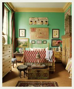 Bedroom could be cluttered but extreme organisation keeps feeling calm and bohemian cool. love the green turquoise wall paint.