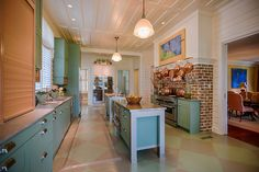 Adjacent to the dining room is the kitchen, which features a decorative brick-clad wall.