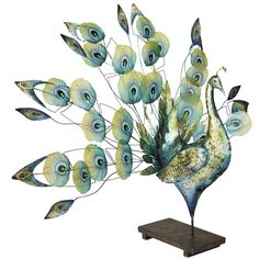 Pretty!  I need this guy somewhere in the house. Our Capiz Shell Peacock is beautifully handcrafted. | Pier 1 Imports
