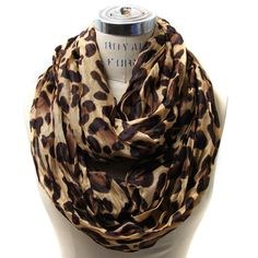 "Scarfand's Leopard Infinity Scarf > Price: $15.00 > Material: 100% polyester Circumfrence: 64"" Width: 28"" > Click on the image for details."