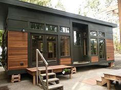 This is the 450 sq. ft. Waterhaus Prefab Tiny Home designed by GreenPod Development and built by Sprout Tiny Homes. From the outside, you'll notice it has an elegant, clean, and modern design…
