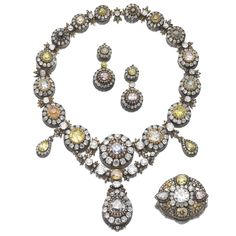 Impressive diamond parure, late 19th century Comprising: a necklace composed of a series of graduated clusters set with cushion-shaped diamonds of various tints, within frames of similarly shaped and rose near-colourless stones, alternating with foliate motifs, the front decorated with two pear-shaped diamonds of yellow tint within a surround of cushion-shaped stones, and a detachable line of cushion-shaped diamonds and foliate motifs,