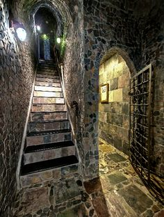 stairway down into medieval style lounge
