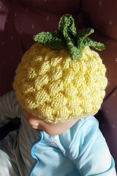 "Crochet Baby Hats Free Knitting Pattern for Pineapple Baby Hat - Leaves are knit on to the hat and not sewn on after, making the hat a ""no finish"" easy knit. Designed by Sara Gerhardt. Baby Hats Knitting, Free Knitting, Knitted Hats, Knitting Yarn, Pineapple Hat, Pineapple Crochet, Baby Hat Patterns, Baby Knitting Patterns, Knitting Designs"
