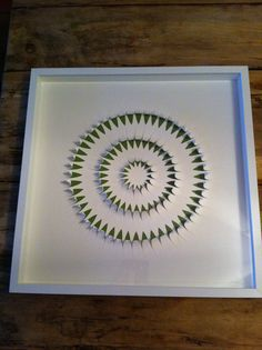 Hand cut, handmade paper- by artist Laura Drayson