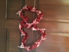 made from dollar store ribbon and wreaths