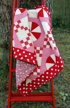 Red, White, and Pink Quilt! Reminds me of Julie with the polka dot border