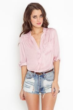 So ready for summer.. this color against tan skin= perfection  Light pink blouse Loose top High-waisted denim shorts Casual