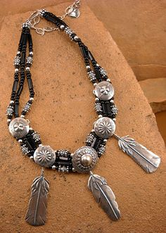 The Mummy's Bundle necklace with three silver feathers, Navajo buttons and black glass beads