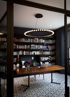 Industrial meets glam in this glassed-in office by Suzy Hoodless.