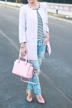 Striped shirt, ripped jeans, pink accessories
