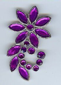 """Shooting Star Flower - Costume Brooch in Nickel Finish with Purple Stones by Pins and Brooches. $4.00. Shooting Star Flower - Costume Brooch in Nickel Finish with Purple Stones. 1.75"""" X 2.5"""" - width or height based on which way it's pinned on. Decorative costume quality jewelry for a lavish, yet inexpensive finishing costume touch! Picture this lovely brooch at your throat on a high Edwardian collar, holding your pearls at just the right angle on Elizabethan or Victo..."""