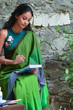 This saree is inspired by Garden Of Eden Collection. This Cotton saree is soft and drapes well on you. The saree has an appliqué jacket and has a tapestry Saree Blouse Neck Designs, Saree Blouse Patterns, Fancy Blouse Designs, Kurta Designs, Dress Patterns, Stylish Blouse Design, Stylish Sarees, Indian Designer Wear, Indian Blouse