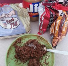 """my """"Monster Snack"""": oats, PB, chocolate chips, butterscotch chips. Microwave 45 seconds, mix & eat! Or roll into balls to take anywhere for a healthy snack/meal sub -all the yummy parts of Monster & No-bake cookies, without the extra sugar & fat! Healthy enough to justify it for lunch every day :)"""