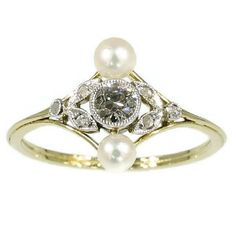 Hey, I found this really awesome Etsy listing at https://www.etsy.com/listing/212046435/pearl-diamond-engagement-ring-antique