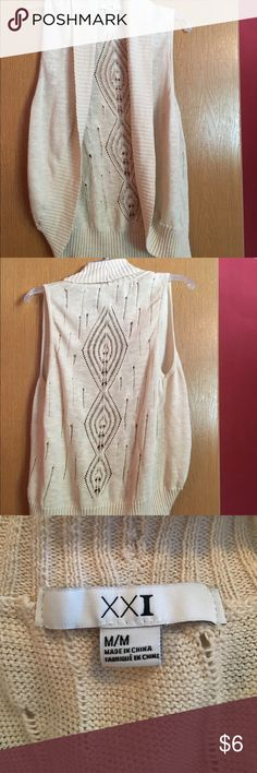 Sleeveless sweater Posh re-sale. I'm selling it for what I paid for it. It's super cute but shorter than I wanted. Forever 21 Sweaters