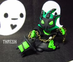 This is a handmade Thresh from league of legends, he is about 2 inches tall and can be made into a charm on request. He was sculpted from fimo clay