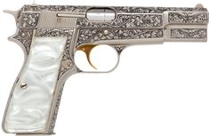 Beautifully engraved Browning Renaissance Hi-Power Semi-Automatic Pistol with Gold- plated trigger