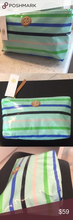 """🆕Tory Burch Cosmetic/Accessory Bag. Medium size Mint Green with striped print bag can be used for your handbag, vanity, gym, travel, etc. Very roomy and fashionable. Zipper pull is leather, as is the Tory Burch Double-T logo on the front with gold hardware. Has 2 very light pen? marks on the front of the bag (photo #7) Purchased a few bags about 2 years ago and never noticed until now.....hence the lower price than normal. New with attached tag and never used. Approximate Measurements: 9.5""""…"""