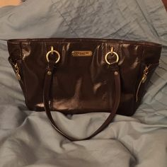 Chocolate Brown COACH Handbag Beautiful chocolate Brown COACH tote with gold detail and pink lining. Gorgeous patent leather, in great condition. Pen marks inside, as noted in last picture. Smoke free, pet free home. Coach Bags Totes