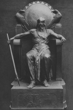 Statue of Odin with his ravens Huginn and Muninn.