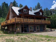 Balcony deck with cedar log railing
