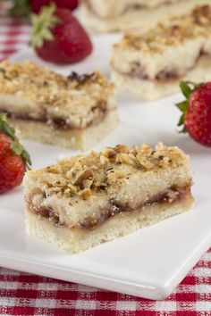 These Strawberry Bars are creamy, buttery, and filled with a strawberry jam center. They're so good, it's hard to have just one!