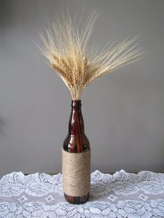 Rustic dried wheat and wine bottle centerpiece wrapped with twine - adds height and country charm to your table. Wine Bottle Centerpieces, Wooden Art, Country Charm, Twine, Diffuser, Rustic Wedding, Vintage Items, Restoration, Wedding Decorations