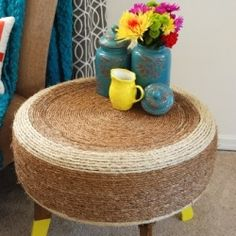 Recycle an old tire, cover it in rope and you have a one of a kind table.