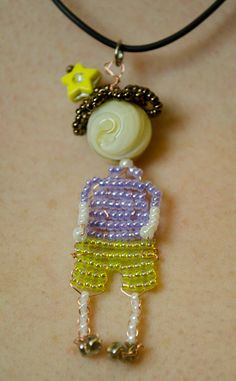 Seed Bead Doll Beaded Bead Necklace Pendant, Beadword. $25.00, via Etsy.