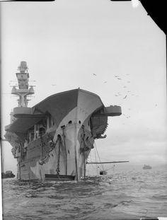 HMS EAGLE moored at Greenock. IWM
