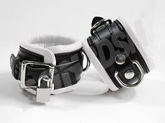 "These high quality hand crafted restraints cuffs ensure that your partner is under your control. Our EXTRA padded restraints will have you snugly locked! Soft padded leather lining keeps your wrists comfortable and protects your pressure points so you can struggle safely! These premium restraints are 7cm (3"") width, and reinforced with three layers of leather.          Features:    1) Ideal to control and restraint your partner!  2) All studs are covered by leather to protect your skin.  3)…"
