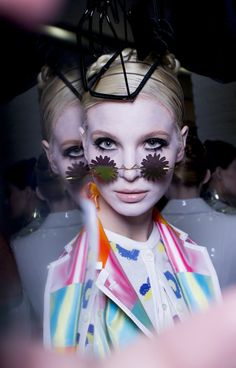 Thom Browne Spring 2015 Backstage. I like the way the make up is so subtle and toned down followed by an extreme pop of bold prints and bright colours, which draws the emphasis to the collection and not the hair and make up.