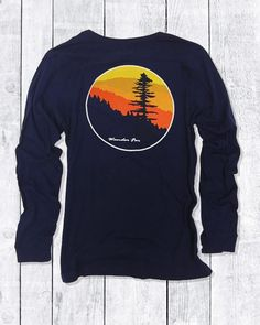 being out on the trail during the golden hour always brings a sense of awe and calm. our timber design was inspired by that magic moment when you find yourself struck by nature's beauty and allure.  casual fit, long-sleeve unisex crew-neck t-shirt.  s~m~l~xl~xxl  100% cotton  the timber design is available as a short-sleeve t-shirt in 100% cotton navy blue and olive green, or as a long-sleeve t-shirt in 100% cotton navy blue, olive green and maroon.