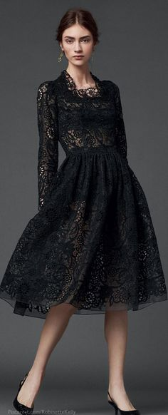 Dolce & Gabbana F/W 2014♥✤ | KeepSmiling | BeStayBeautiful - I like this lace dress........ but this girl looks like she totally hates it!