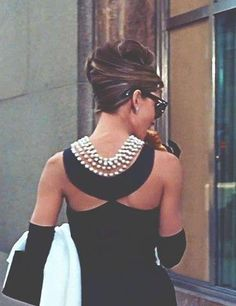 Audrey ahead of her time with the backless trend and jewelry!
