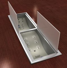 """The Electri-Wave is a 30"""" decorative trough packed with class, style and elegance. Its modern design provides an elegant solution for designers or manufacturers looking for a fresh alternative to traditional designs. It lies flat within the table surface to maximize workspace while maintaining the sleek table design. Electri-Wave's double, swing doors incorporate frosted glass lids and can open from either side of the table for easy cable management. #ConferenceTable #PowerDataGrommet"""