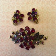 A personal favorite from my Etsy shop https://www.etsy.com/listing/478594615/vintage-estate-parure-red-rhinestone