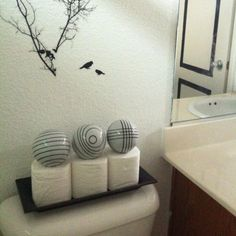 Toilet Paper Storage...looks More Decorative Than Just A Bunch Of Rolls...  ~ And Nice Placement Of Wall Stickers