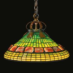 "Tiffany Studios ""GEOMETRIC BANDED TURTLE-BACK"" CHANDELIER shade impressed TIFFANY STUDIOS NEW YORK leaded glass and patinated bronze 31 3/4  in. (80.6 cm) drop 20 1/2  in. (52 cm) diameter of shade circa 1905"